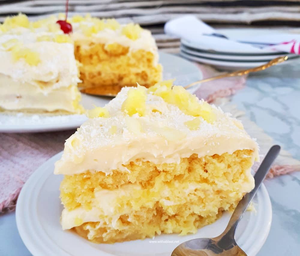 Pina Colada Cake is so soft and moist with an equally delicious frosting - filled with the flavors of the tropical cocktail which just screams Summer !
