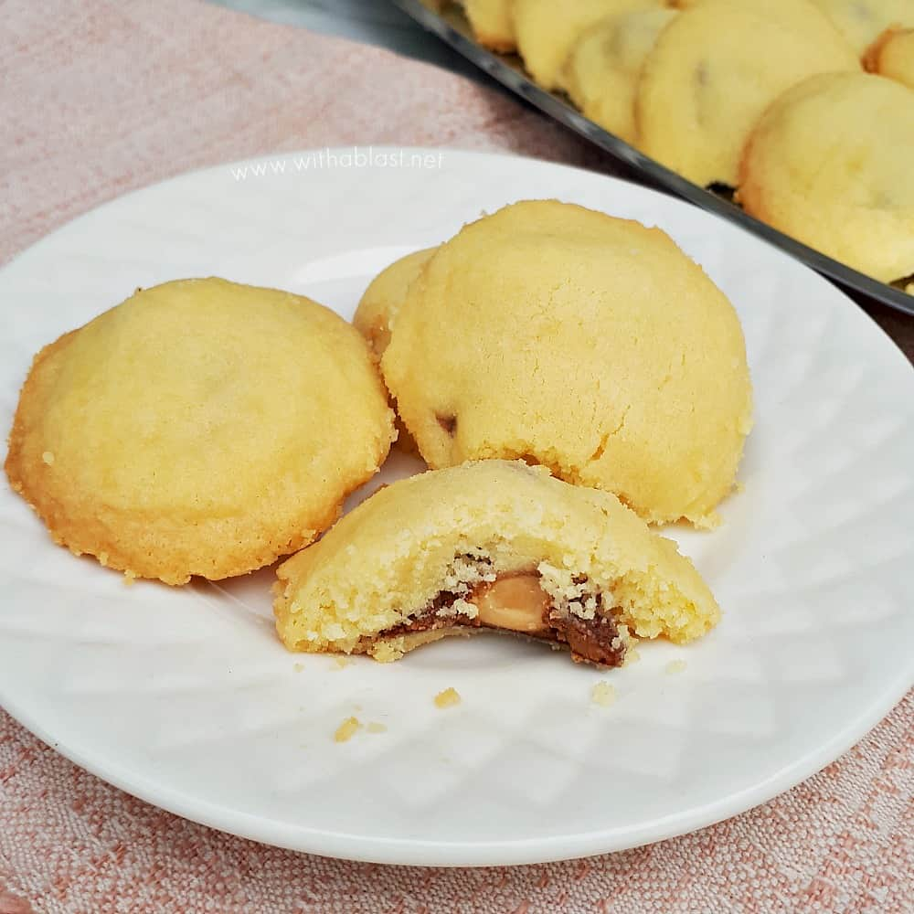 Buttery Shortbread Surprise Cookies have a delicious whole nut chocolate center - pure cookie bliss and you will not be able to stop eating these cookies!