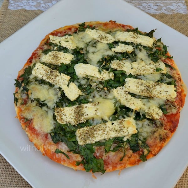 Have this quick and easy Feta and Spinach Pizza for a light meatless Monday dinner - a low-fat version is also given for this popular pizza
