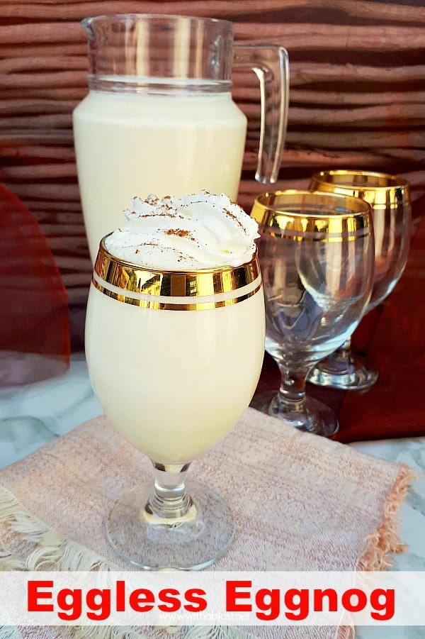 Quick, easy and delicious recipe for thick EggLess Eggnog made with standard pantry ingredients (boozy or not!) and the must have drink for Christmas ! #EgglessEggnogRecipe #NoEggEggnog #EggnogRecipes #ChristmasDrink