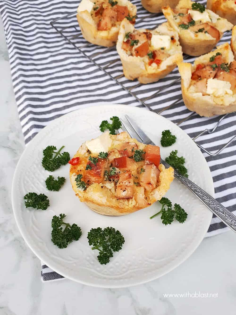A very versatile recipe for Chicken and Creamy Garlic Bread Baskets - serve as a light dinner, snack or as an appetizer. Perfect to use up leftover Chicken and Bread.