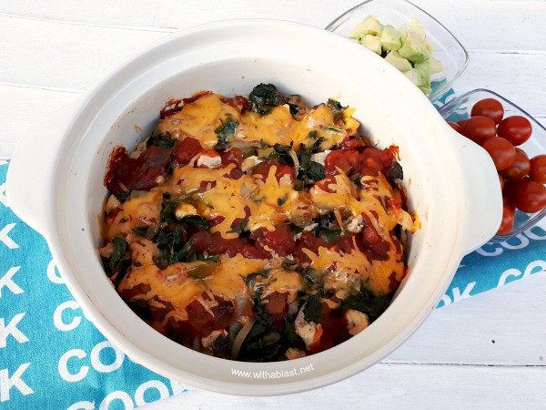 Layers of cheesy, comfort food ! The spinach makes this Chicken Taco Casserole and even non-spinach eaters loves it