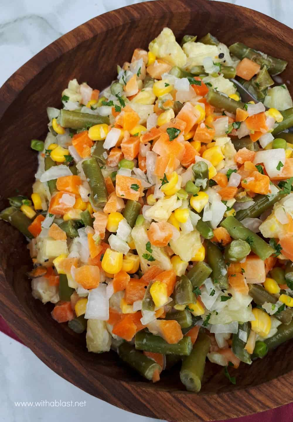 Tropical Vegetable Salad is loaded with vegetables and the added Pineapple makes the salad a hit, especially with kids - savory-sweet crunchy delicious!