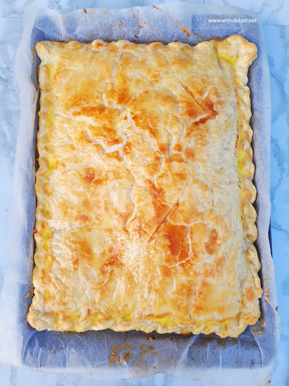 Ham and Cheese Pie is so quick and easy to make using a sheet pan and you can easily fit two pans into your oven - serve as a snack, breakfast or light dinner