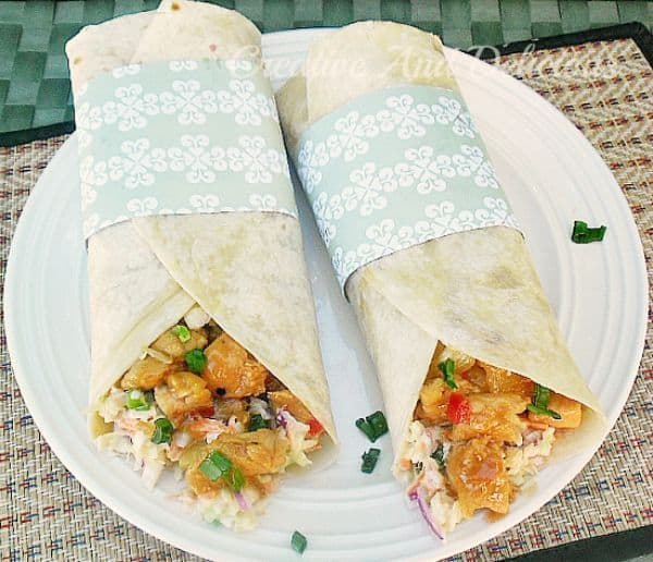 These Sweet Chili Chicken Tortillas with Coleslaw is a delicious, filling light dinner or lunch and is packed with sweet, sour and salty flavors #SweetChiliChicken #ChickenWraps #ColeslawRecipe