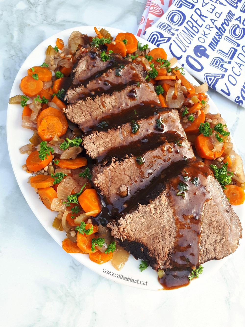 Best Slow-Cooker Pot Roast turns out so tender and juicy with vegetables all cooked in the slow-cooker - no fuss recipe and ideal for a Sunday roast !