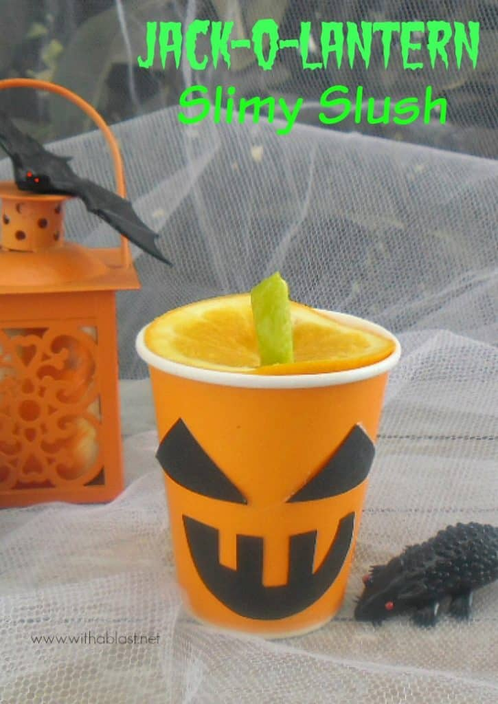"Jack-O-Lantern Slimy Slush is a fun Halloween orange drink - non-alcoholic, quick recipe and easy to make the ""Lanterns"", using all standard pantry ingredients. #Halloween #HalloweenDrink #JackOLantern www.withablast.net"