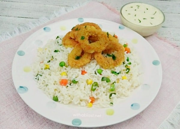 Delicious crumbed Calamari, served over Vegetable Rice and a Garlic-Lemon Dip on the side. Complete meal in no time at all !