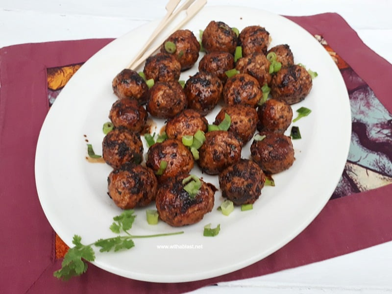 Slightly spicy, juicy Asian Chicken Meatballs, with a salty/sweet glaze are perfect to serve as an appetizer or as part of your savory party platter - make-ahead friendly recipe