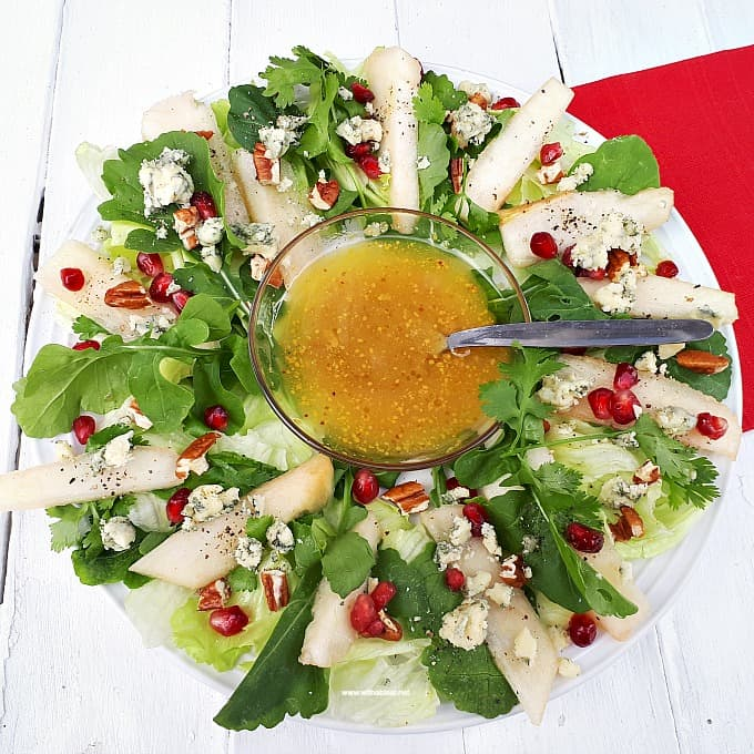 Christmas Wreath Pear Salad is a refreshing salad addition to your Christmas menu, with pears, nuts, pomegranates and more - Prepping to serving within minutes