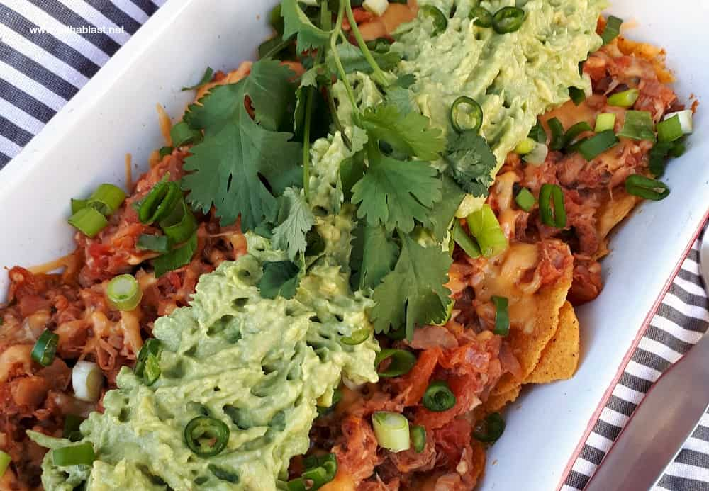 Quick Tuna melt Nachos is a cheesy, tomato rich, quick and easy dish to be served as an appetizer, snack and perfect as a light dinner too