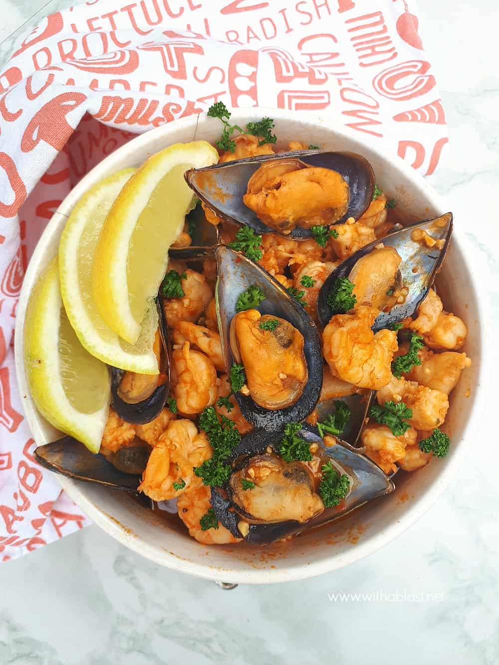 Red Prawns and Mussels are slightly spicy and nestled in a creamy paprika tomato sauce - so quick and easy to serve for dinner or as an appetizer