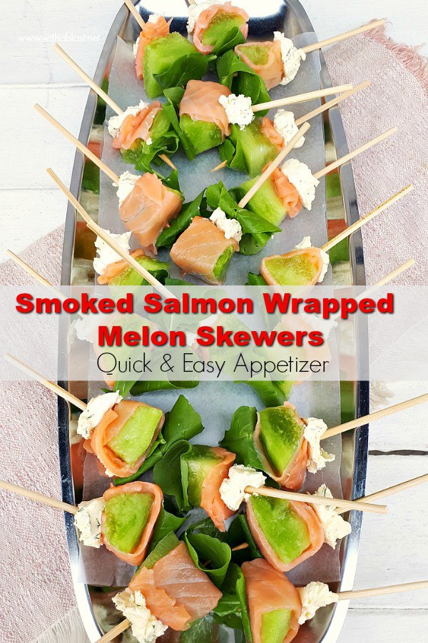 Smoked Salmon Wrapped Melon Skewers are quick and easy to make. Dill Mascarpone and Arugula complete this very tasty, elegant appetizer #Appetizer #SalmonRecipes #SeafoodRecipes #SalmonAppetizer #NewYearsEveSnacks