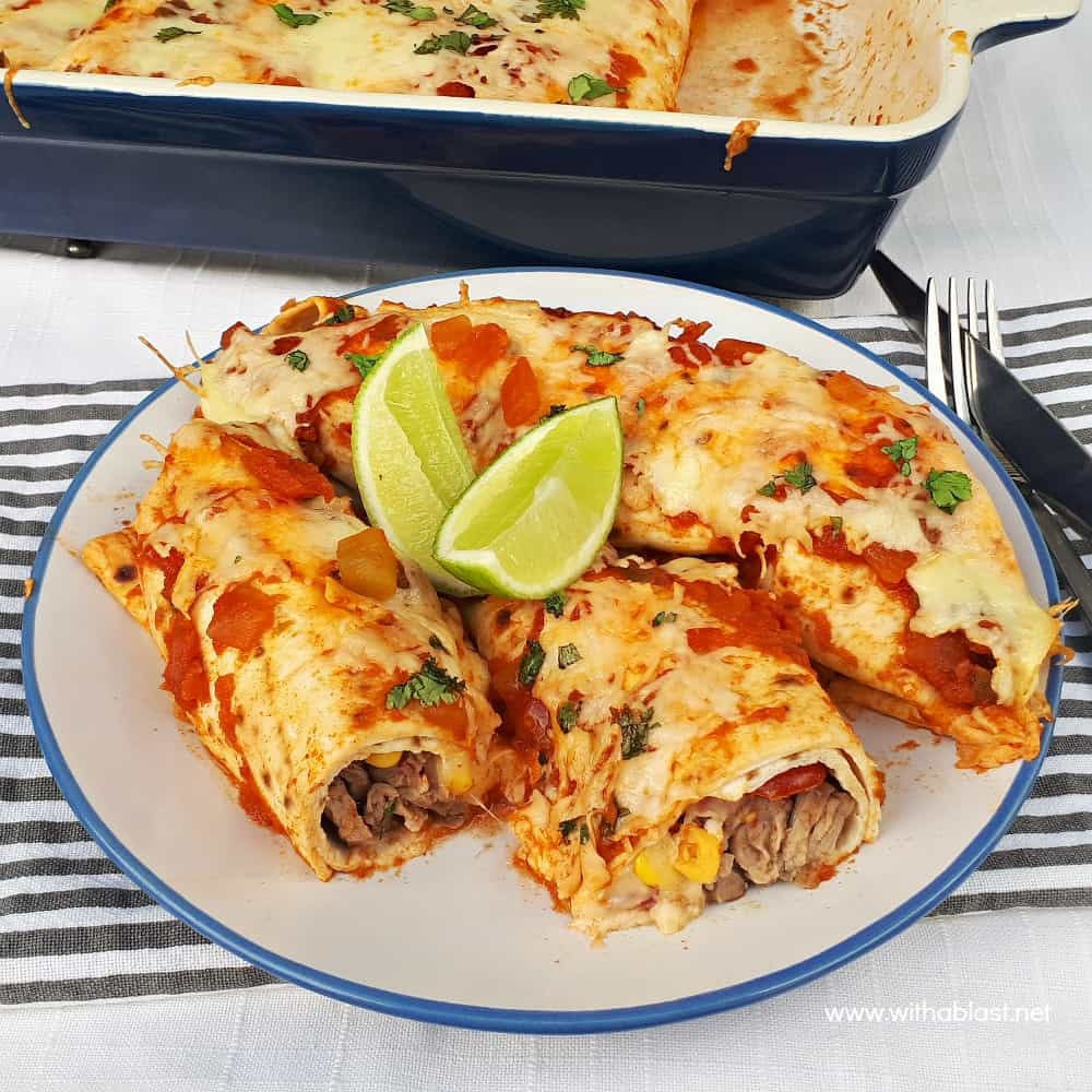 Perfectly marinated Tequila Lime Steak Enchiladas are loaded with steak, a delicious salsa, cheese and topped with chunky salsa sauce and more cheese !