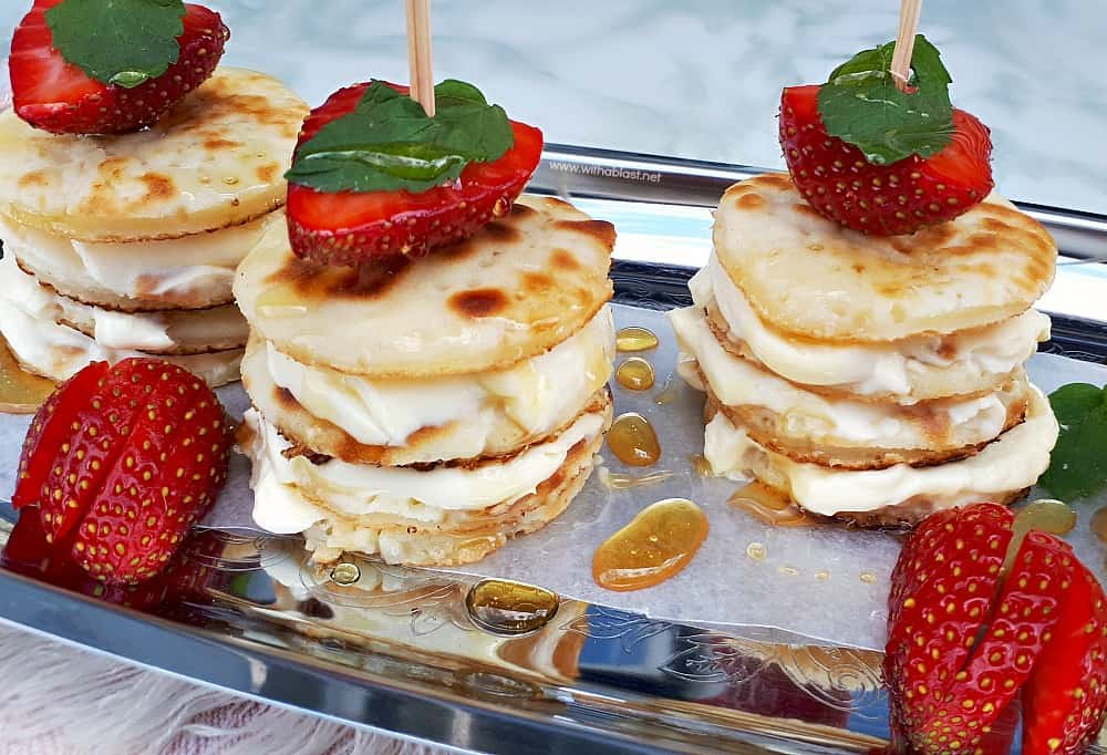 Deliciously Mascarpone Filled Mini Pancakes Stacks are perfect for a special breakfast, brunch or even a sweet treat. Perfect with Strawberries and drizzled with Honey!