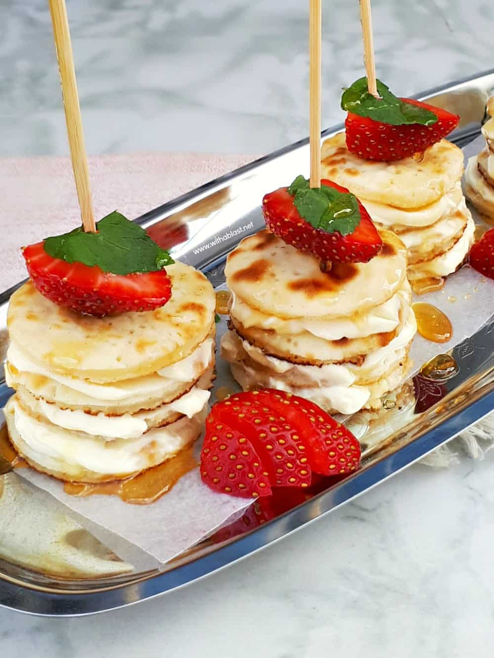 Deliciously Mascarpone Filled Mini Pancakes Stacks are perfect for a special breakfast, brunch or even a sweet treat. Perfect with Strawberries and drizzled with Honey! #PancakeStacks #MiniPancakes #FilledPancakes #BreakfastRecipes #SweetTreatRecipes