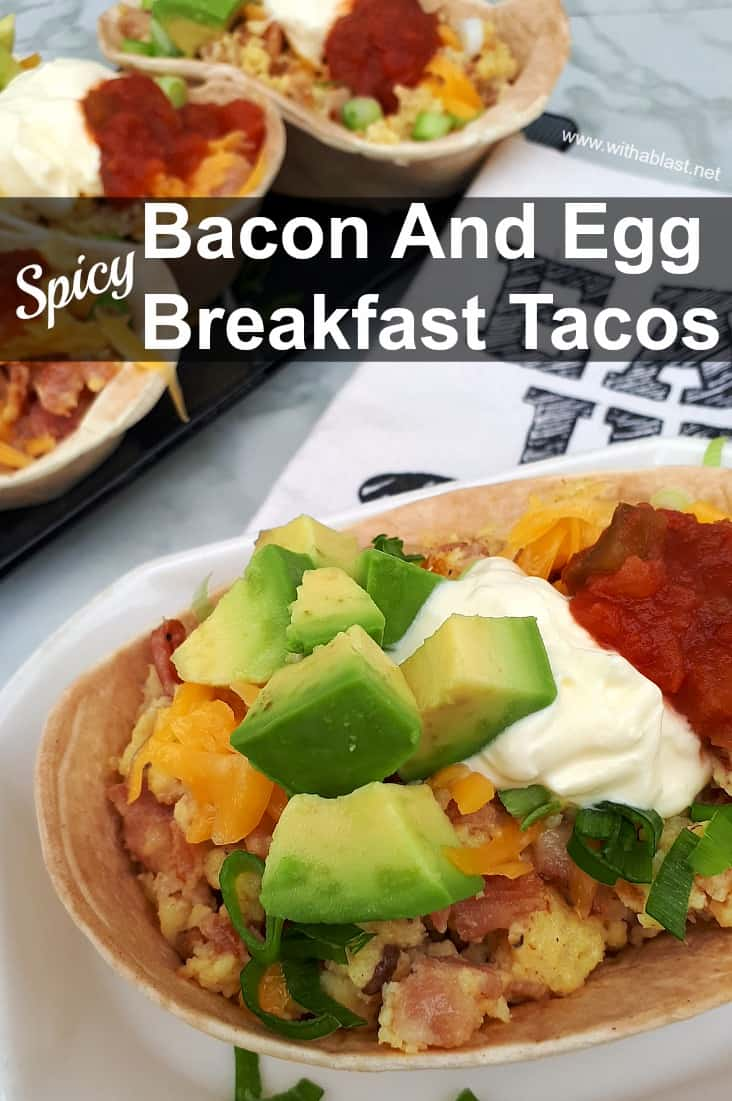 So quick ! Deliciously spicy filled Bacon and Egg Breakfast Tacos with all the trimmings !
